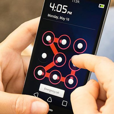 A pair of hands holding and swiping an unlock pattern on a mobile device